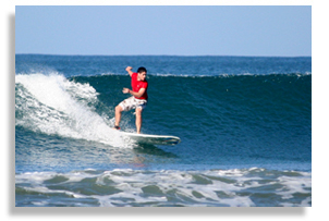 John surfing photo